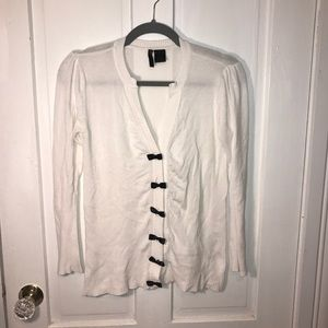 White cardigan w black bows
